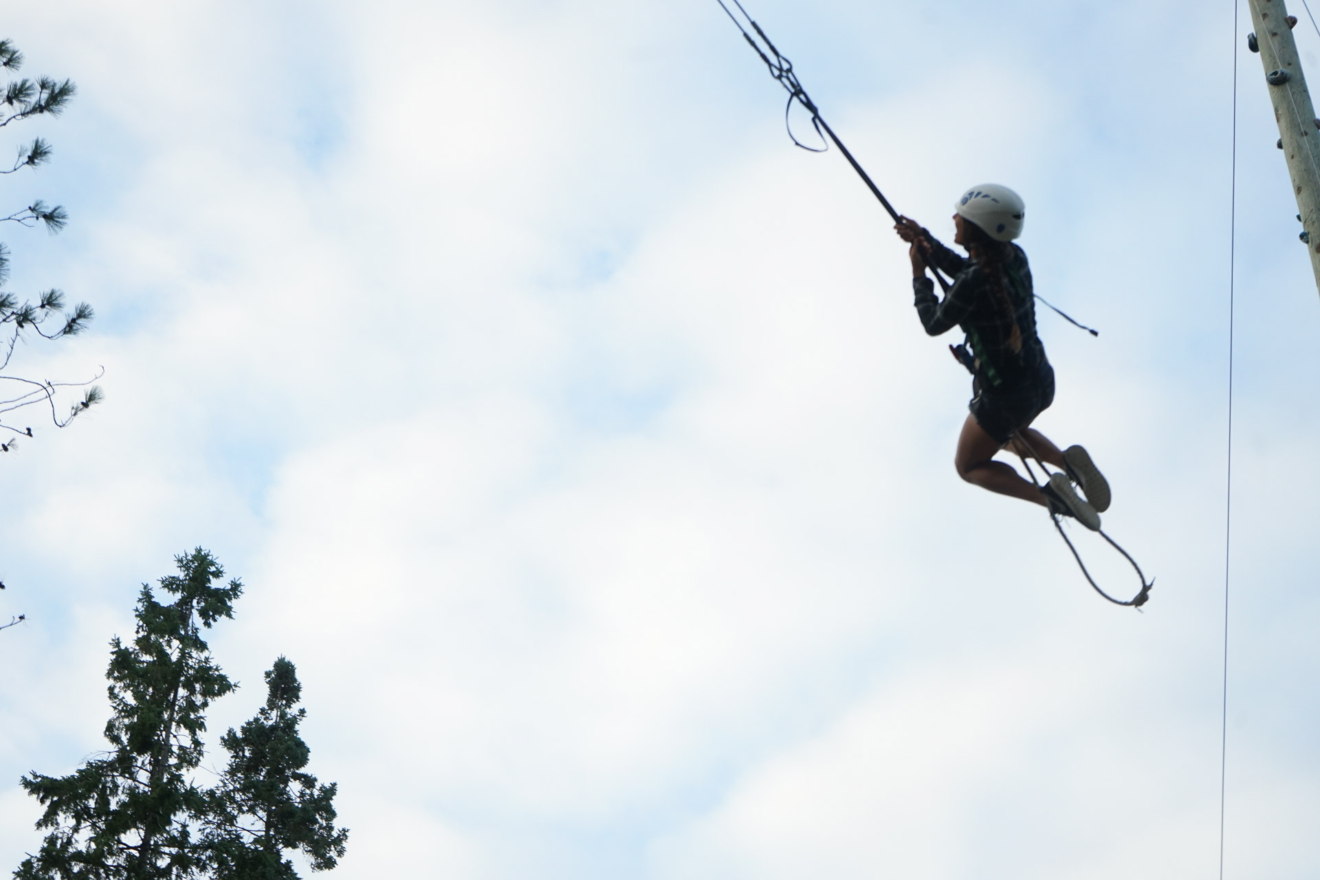 A young person swinging on a rope